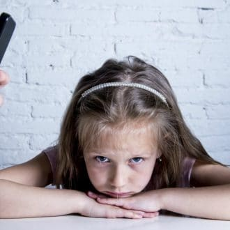 A Parent's Use of Tech May Lead to Big Problems for Kids