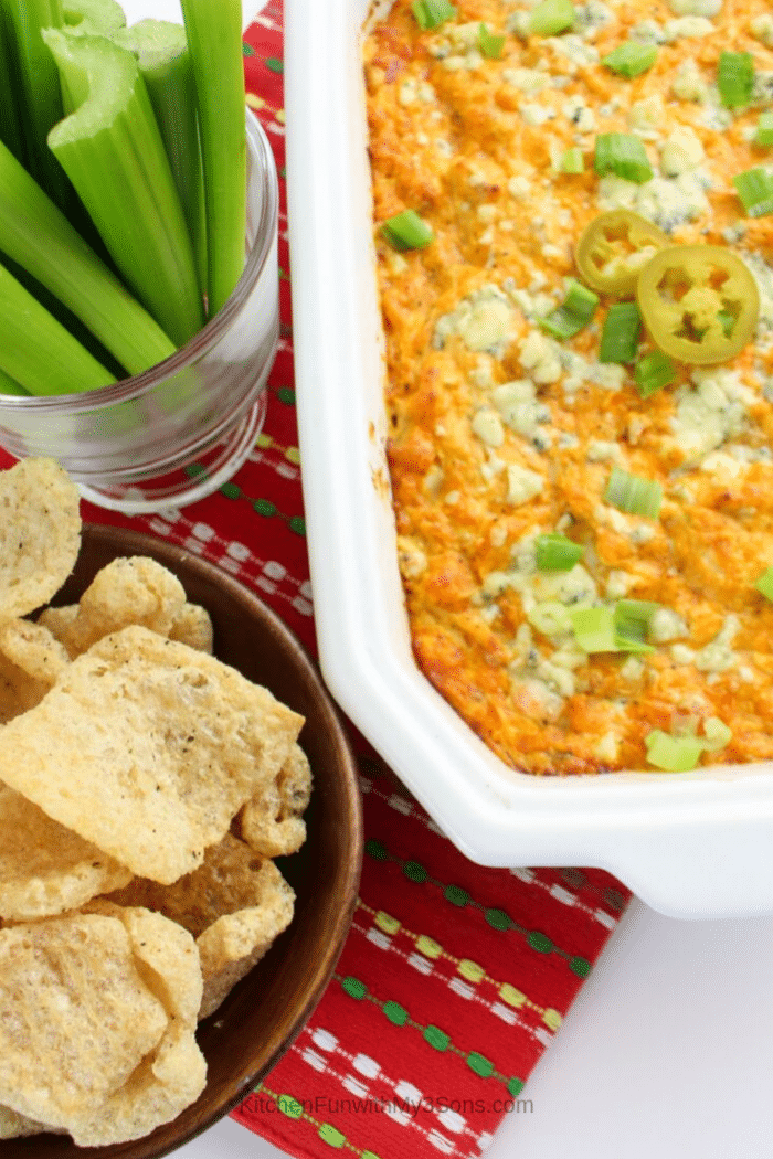 A scoop of easy buffalo chicken dip with blue cheese on a celery stick (1)