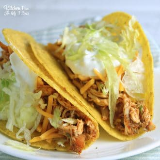These Slow Cooker Ranch Chicken Tacos need just 4 ingredients and very little work. This is your new easy dinner recipe for sure!