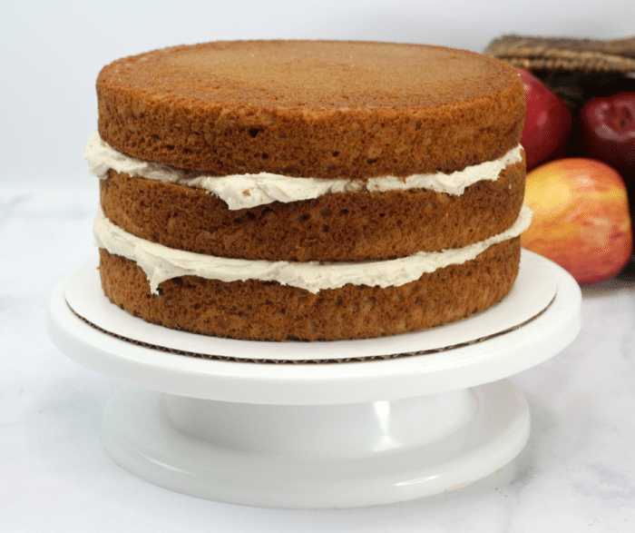 A layered apple spice cake with frosting between layers