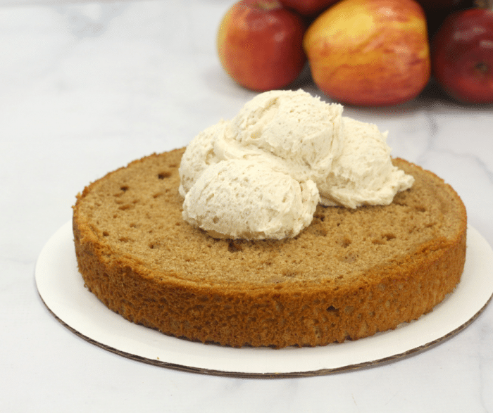 Adding frosting to the apple spice cake