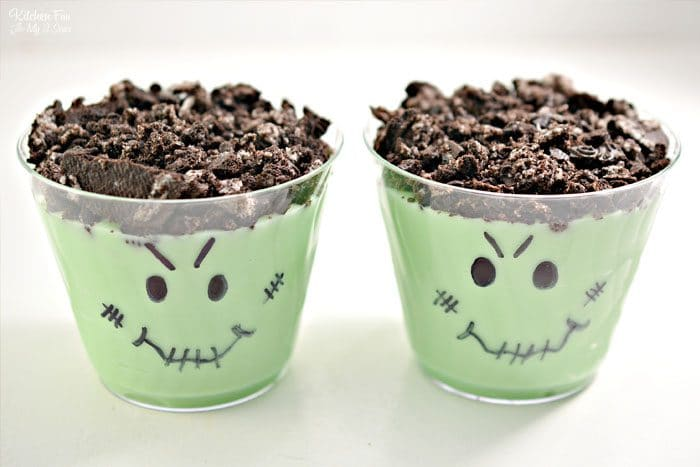 These Halloween Pudding Cups with Oreo cookies are a really fun treat to make with kids. Grab a marker and let's make a Jack-O-Lantern and Frankenstein!