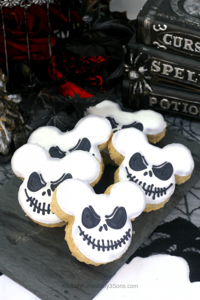 Jack Skellington Mickey Mouse Rice Krispie Treats recipe sitting on a black napkin in front of spooky books