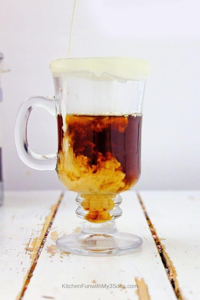 Large clear mug being filled with coffee and chocolate for pumpkin latte recipe