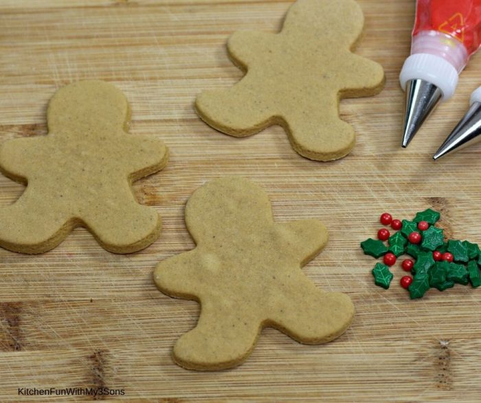 Blank gingerbread man cookies on a cutting board