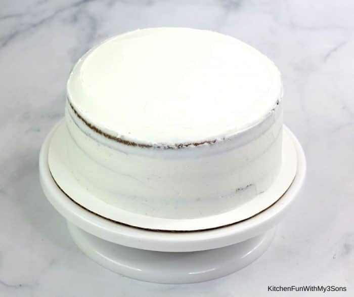 Icing a gingerbread layer cake