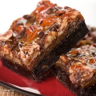 Pecan Pie Brownies are a yummy dessert mashup combining rich chocolate brownies and pecan pie. If you're looking for a new way to serve your pecan pie this Thanksgiving, try this recipe out!