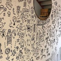 Kid Told Not to Doodle in Class Gets Hired by Restaurant to Decorate Their Walls