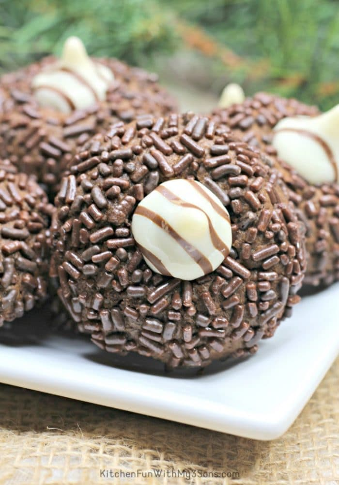 Chocolate sprinkled covered thumbprint cookie
