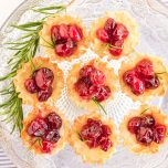 Cranberry Brie Bites is a quick Christmas snack that is beautiful and delicious. A pastry filled with cheese and fresh cranberries is perfect for a holiday party.