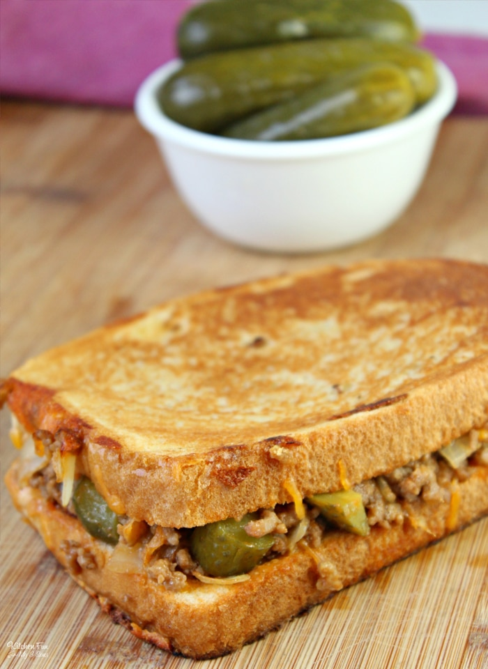 Dill Pickle Sloppy Joe Grilled Cheese is a fun new take on an old favorite. This sandwich is not just grilled with cheddar cheese and pickles but also delicious sloppy joe mixture.