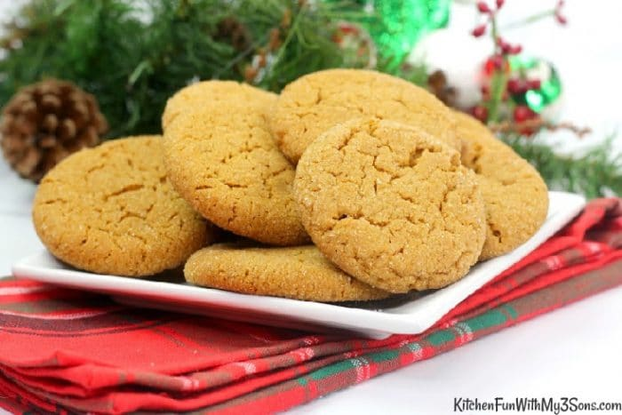 Holiday decorations in front of a white plate of cookies