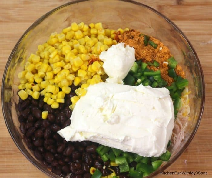 Glass bowl of ingredients for chicken dip