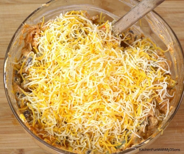 Mixing together ingredients for chicken enchilada dip