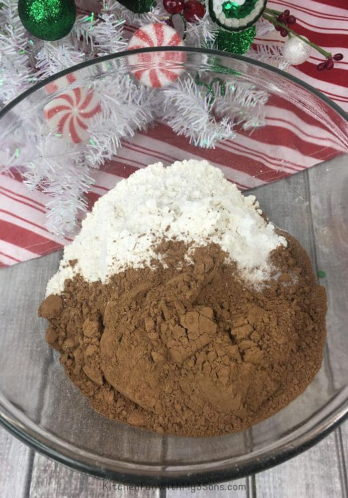 Mixing bowl of cocoa and sugar for thumbprint cookies