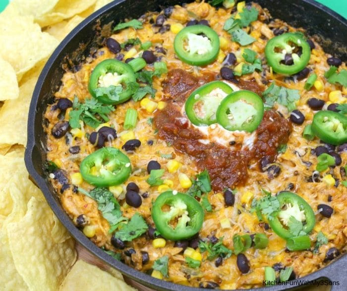Up close picture of cast iron chicken enchilada dip