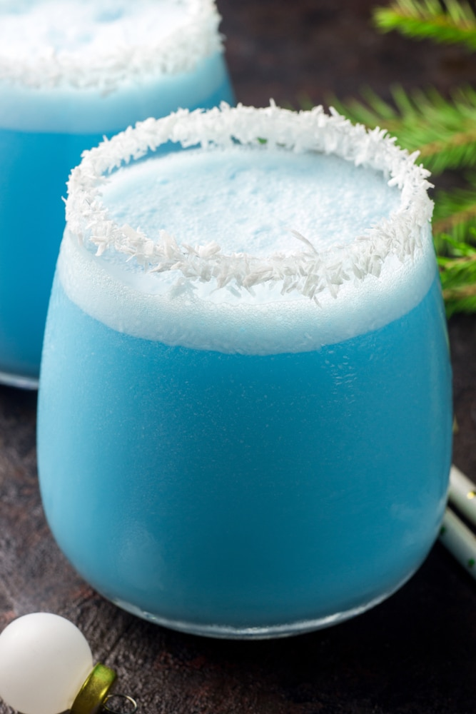 Close up of a Jack Frost Cocktail with a coconut rim