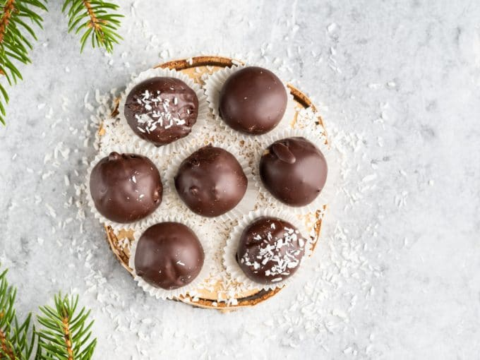 Chocolate Covered Coconut Bon Bons on a wood plate