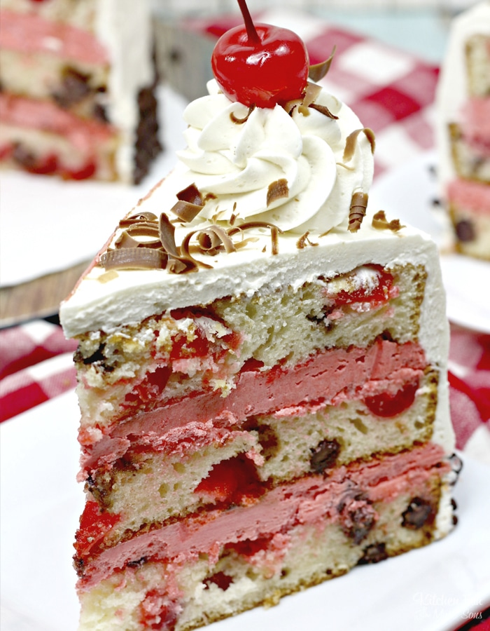Cherry Garcia Cake is stacked with layers of vanilla cherry cake and homemade cherry icing. This cake looks like it came straight from a bakery!