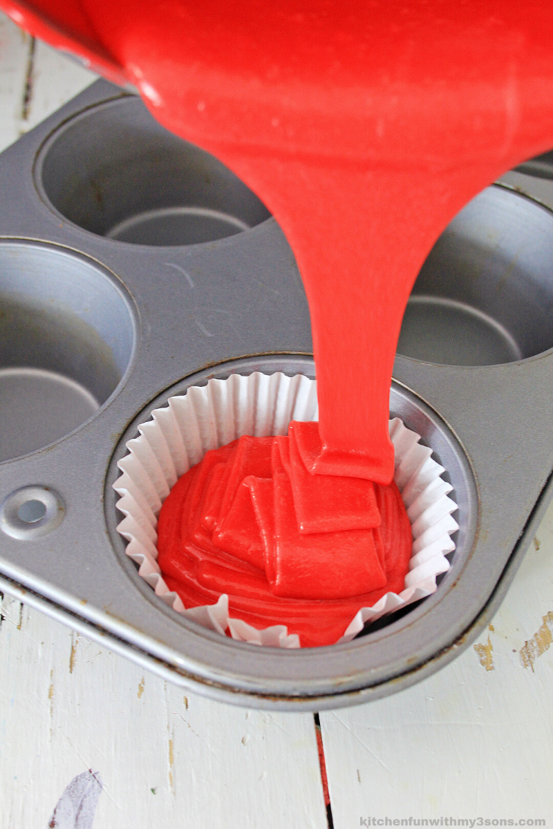 pouring batter into cupcake tin