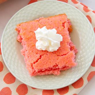 strawberry soda cake on a white plate