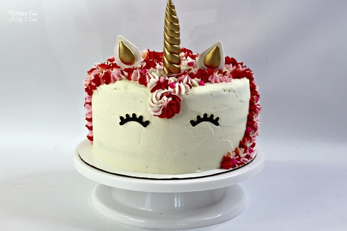 A Valentine Unicorn Cake is the sweetest dessert to share with your kids on Valentine's Day. It's a triple layered, moist vanilla cake with homemade vanilla frosting on top.