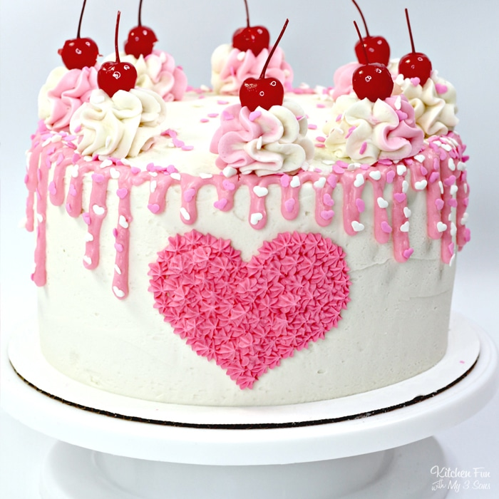 Our Valentines Day Cake is absolutely beautiful and super tasty! It's a triple layer pink and white cake with homemade vanilla frosting on top.