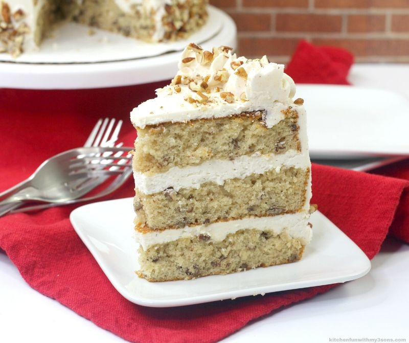 slice of brown butter pecan cake on a white plate