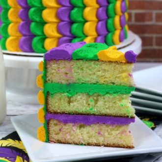 Best Ever Mardi Gras Cake on a white plate