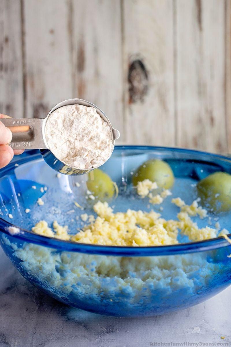 adding flour to cookie dough