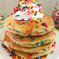 Rainbow Funfetti Pancakes on a white plate