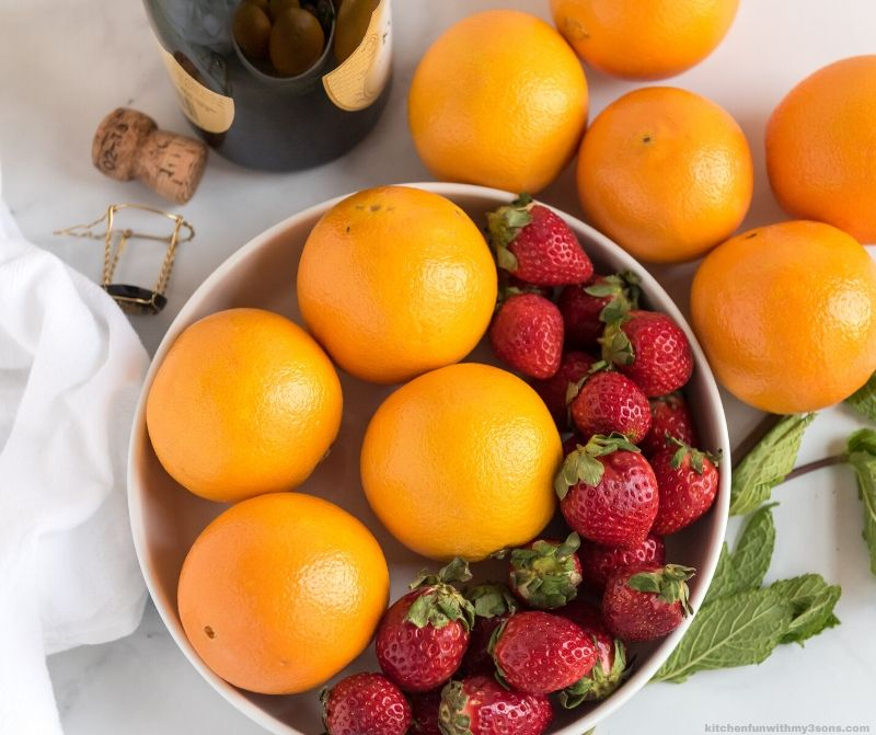 orange and strawberries in a bowl