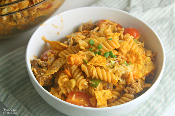 Taco Pasta Salad is an easy pasta salad recipe we love serving at get-togethers. This hearty salad has one secret ingredient that gives it extra flavor: Doritos.