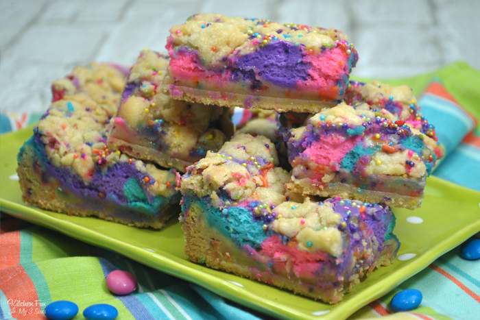 Unicorn Cheesecake Bars with a soft sugar cookie crust and colorful cheesecake is a delicious dessert and perfect for a unicorn birthday party.