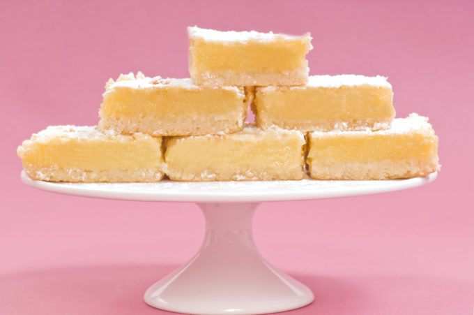 Stacked Lemon Bars on a Cake Stand