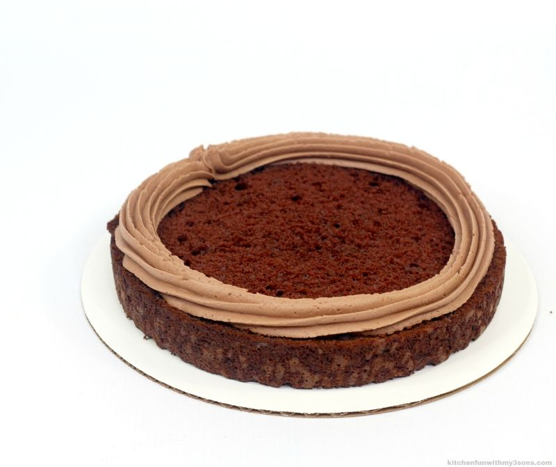 chocolate cake layer with frosting ring