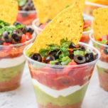 7 Layer Dip Cups are the best appetizer to serve at your next party. This recipe is perfect for Mexican dinner night and goes perfect with tacos and burritos.