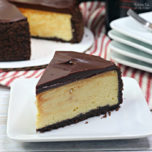 Baileys Cheesecake is a delicious recipe with cream cheese, Bailey's Irish Cream and coffee on an Oreo crust and chocolate ganache on top.