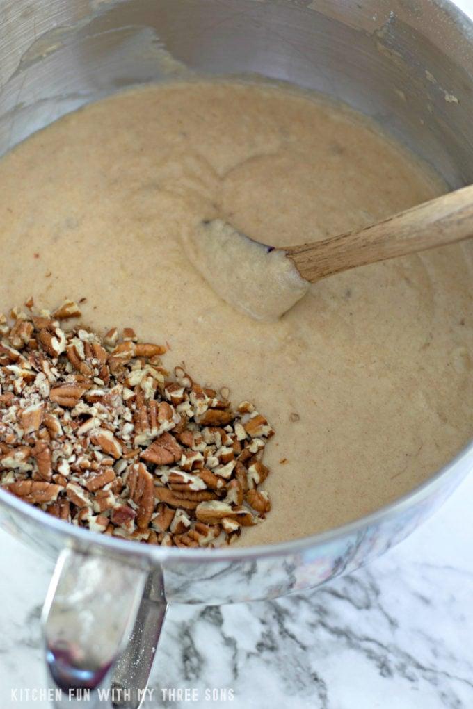 Mixing pecans into banana bread batter