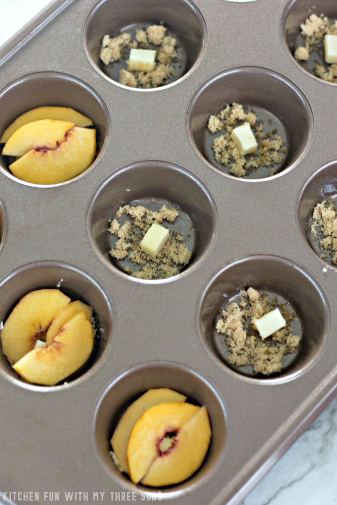 butter and brown sugar with peaches in a muffin pan