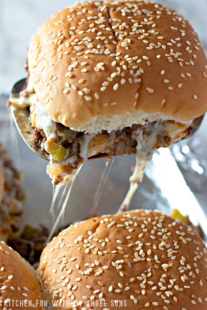 Serving Philly Cheesesteak Sloppy Joes with a spatula