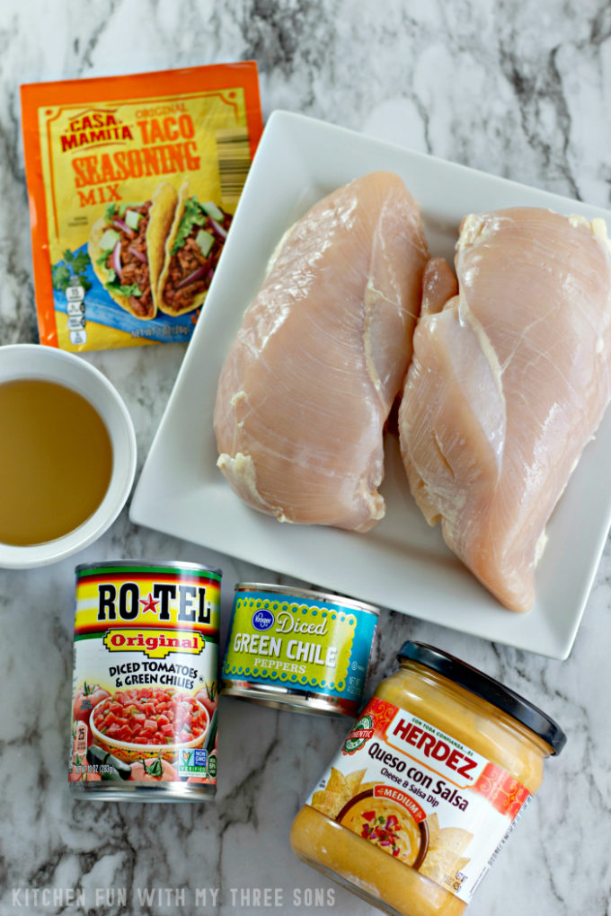 ingredients to make Slow Cooker Cheesy Chicken Tacos on a white marble counter