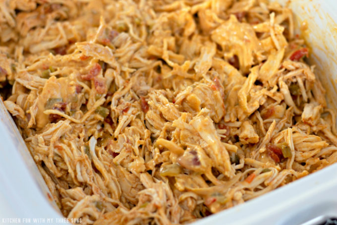 shredded chicken with cheese and salsa in a slow cooker