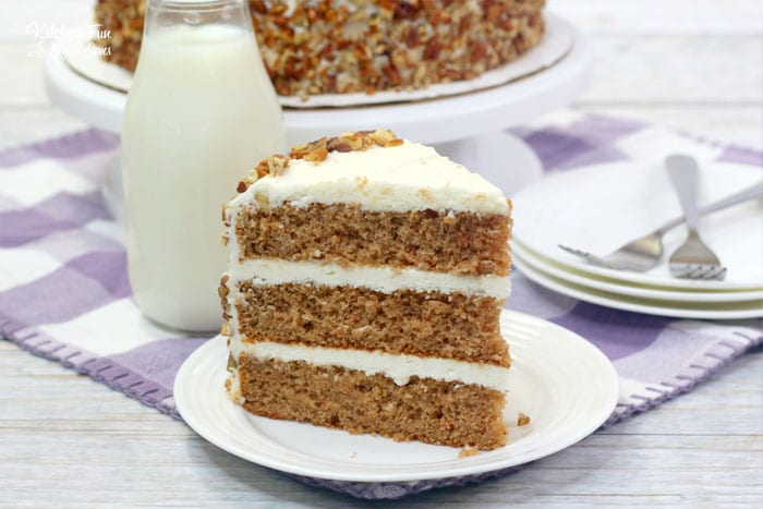 This Carrot Cake with nuts is layer after layer of moist cake with a homemade cream cheese frosting in between.