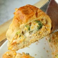 A Chicken And Broccoli Crescent Roll Ring with broccoli florets and cheddar cheese is the perfect weeknight dinner recipe.