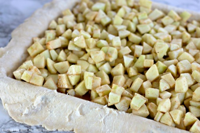 filling homemade pie crust with chopped apples