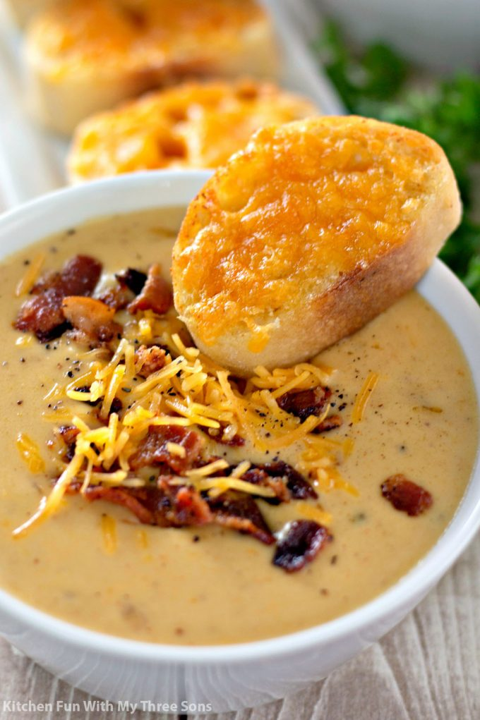 a bowl of Beer Cheese Soup with Garlic Cheese Toast