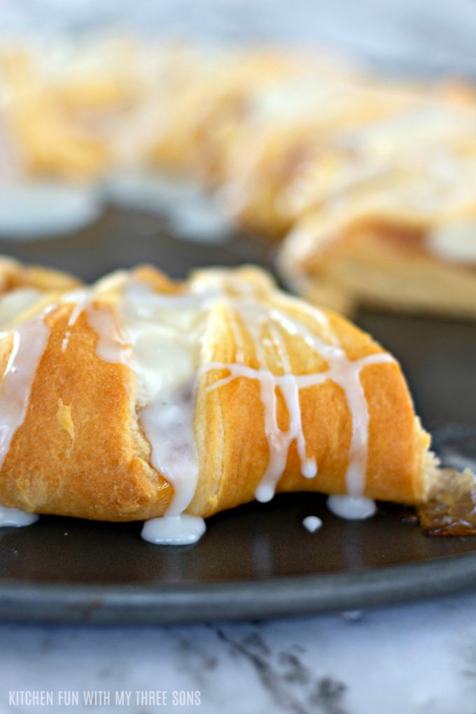 frosting drizzled over a danish