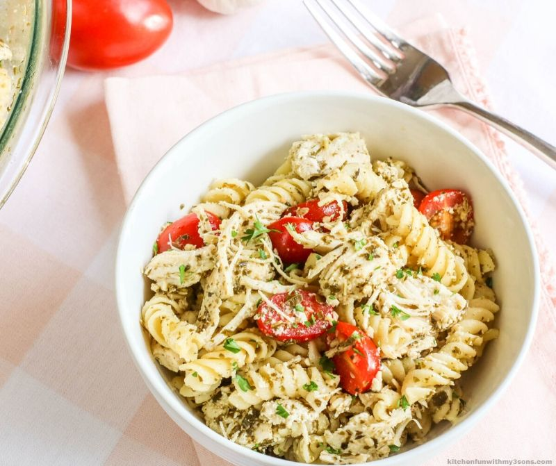 Chicken Pesto Pasta with Tomatoes in a white bowl