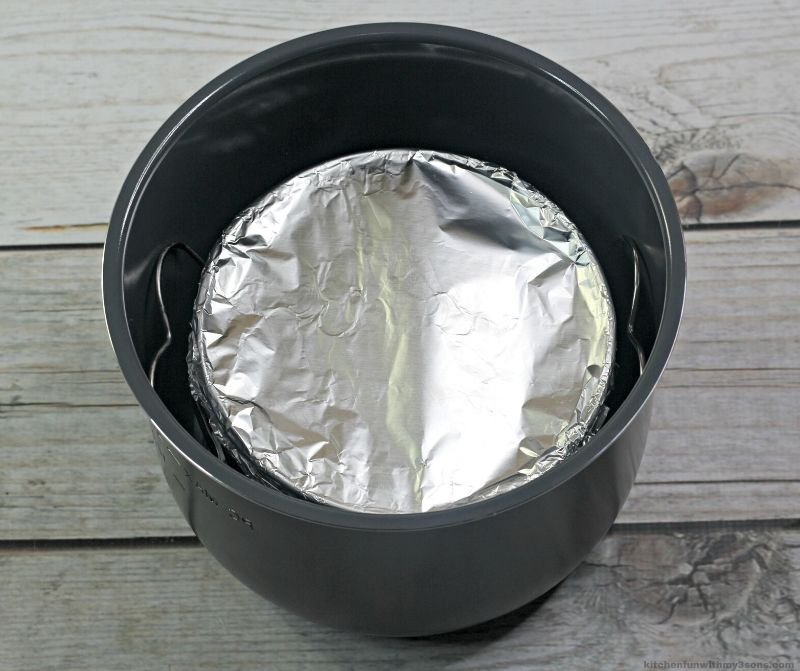 cheesecake in instant pot covered in foil